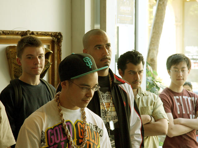 Participants reflect over slaps at Verse Beat Battle in Oakland CA 2008.