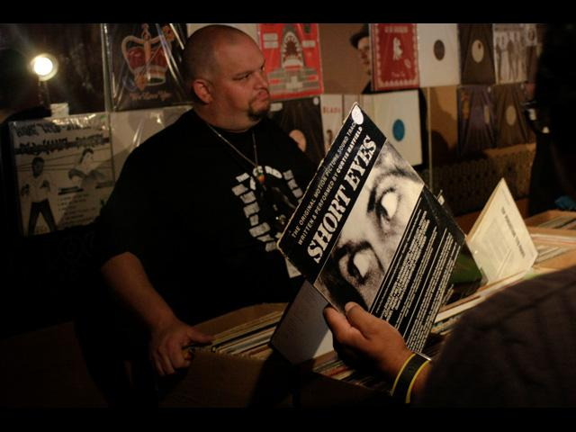 Record vendor posted with his merchandise inside the Jazz Club - BSM June 2011
