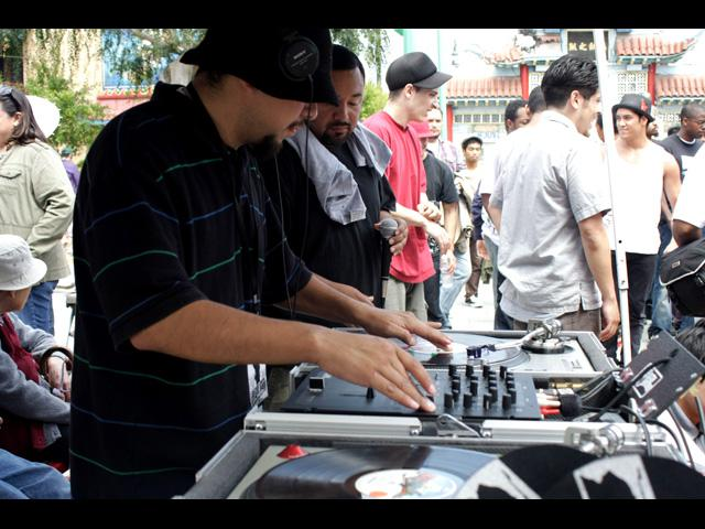 DJ spinning on the 1's & 2's at the b-boy / b-girl competition - Beat Swap Meet 2011