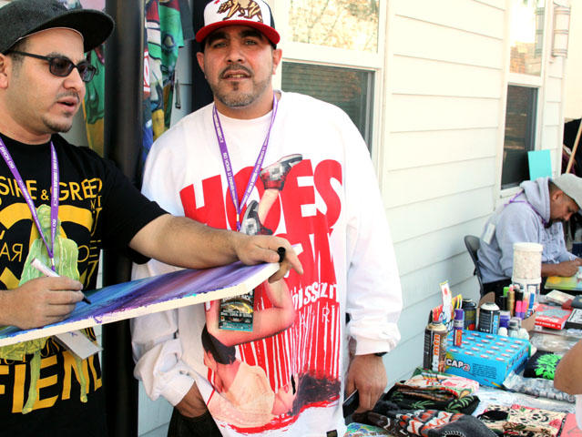 Fernando and Adon rep the art community at ArtArk Gallery Bring It Back 09